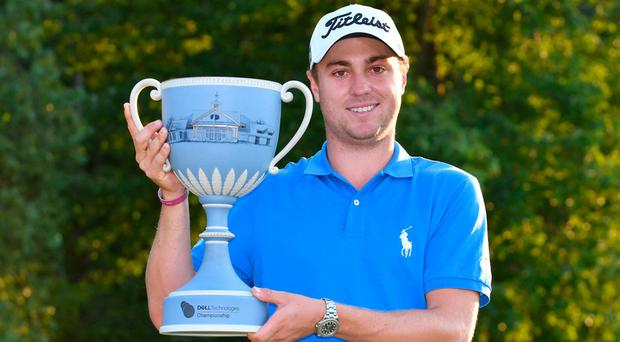 Justin Thomas poses with the Dell Technologies Championship trophy. Photo: Mark Konezny-USA TODAY Sports
