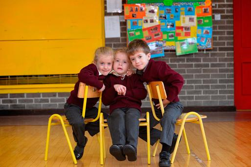 Triplets Lucy, Laura and Donal McMahon. Picture: Domnick Walsh