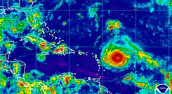 This Monday, Sept. 4, 2017, satellite image provided by the National Oceanic and Atmospheric Administration shows Hurricane Irma nearing the eastern Caribbean. Hurricane Irma grew into a powerful Category 4 storm Monday. (NOAA via AP)
