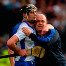 Pauric Mahony of Waterford and his manager Derek McGrath dejected after the All Ireland final