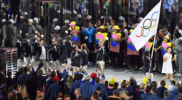 File photo taken in August 2016 shows the Refugee Olympic Team marching during the opening ceremony of the Rio de Janeiro Olympics at the Maracana Stadium. The International Olympic Committee Executive Board agreed on July 9, 2017, to continue to support refugees by getting them involved in the 2020 Tokyo Olympics. (Kyodo) ==Kyodo (Photo by Kyodo News via Getty Images)