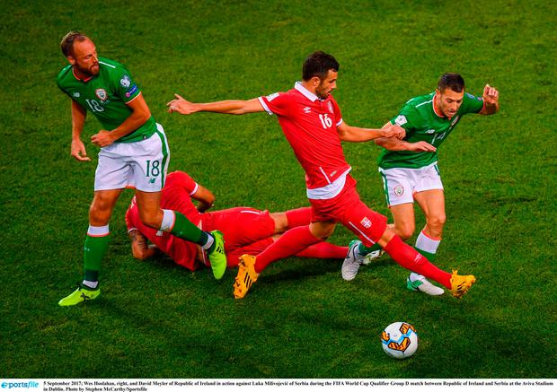 Wes Hoolahan, right, and David Meyler of Republic of Ireland in action against Luka Milivojević of Serbia
