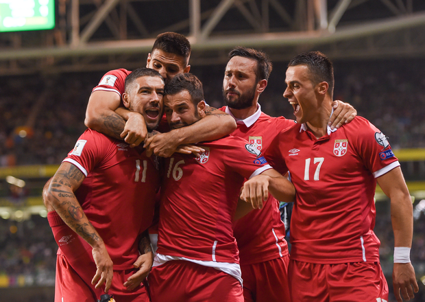 Aleksandar Kolarov of Serbia, left, celebrates with teammates after scoring his side's first goal during the FIFA World Cup Qualifier Group D match between Republic of Ireland and Serbia at the Aviva Stadium in Dublin. Photo by Seb Daly/Sportsfile