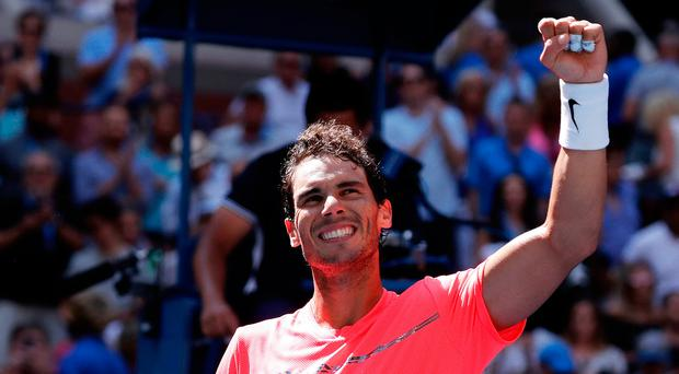 Rafael Nadal waves to his supporters after beating Alexandr Dolgopolov Photo: AP