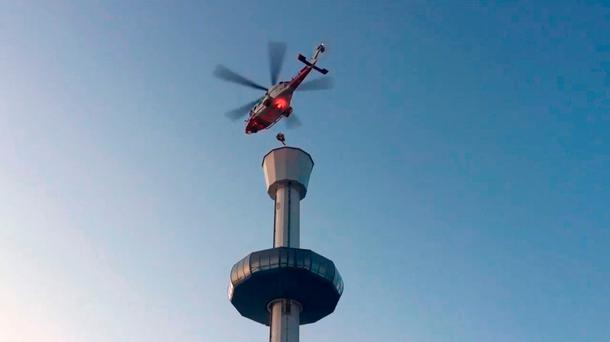 Screen grab taken with permission from the Twitter feed of @DWFRSFireSafety of a person being winched to safety from the gondola of the Jurassic Skyline tower in Weymouth by a Coastguard helicopter, after the efforts to free the stuck gondola failed. Credit: @DWFRSFireSafety/PA Wire