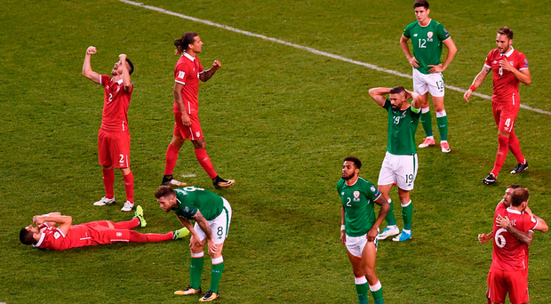 Serbia and Republic of Ireland players react at the final whistle