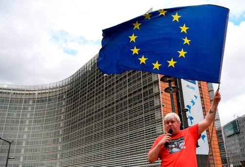 Anti-Brexit activist Drew Galdron, who is also an impersonator of British Foreign Secretary Boris Johnson, takes part in a demonstration against the UK's decision to leave the EU in front of the European institutions in Brussels. Picture: AFP