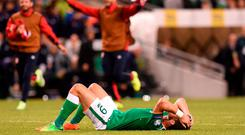 Shane Long reacts after defeat to the Serbians at the Aviva in Dublin. Photo: Matt Browne/Sportsfile