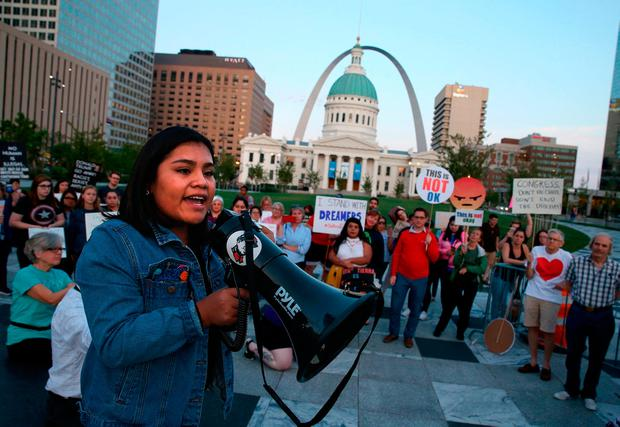 Vivian Garcia Cruz, 18, a self-described DACA student speaks at a rally in St. Louis' Kiener Plaza on Tuesday, Sept. 5, 2017, as supporters of the Deferred Action for Childhood Arrivals gather to voice their opposition to President Trump's decision to end the federal program from the Obama administration. (Christian Gooden/St. Louis Post-Dispatch via AP)