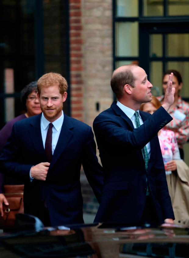 The Duke of Cambridge and Prince Harry leave after their visit the new Support4Grenfell community hub, which is offering advice and counselling to families affected by the Grenfell Tower fire