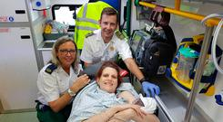 Paramedics Sharon Mooney and Darren Galvin (Defence Forces) with mother Caroline Worthington and newborn baby Faolán