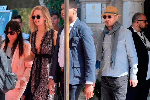 Actress Jennifer Lawrence and director Darren Aronofsky (R) leave the Excelsior Hotel during the 74th Venice Film Festival on September 5, 2017 at Venice Lido. / AFP PHOTO / Tiziana FABITIZIANA FABI/AFP/Getty Images