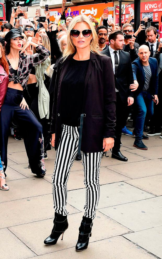 Kate Moss attending the Reserved store opening on Oxford Street, London