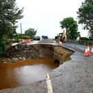 Rains washed away a section of main road in Quigley's Point, Co Donegal in 2017. Photo: Clodagh Kilcoyne/Reuters