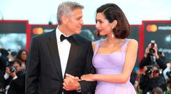 Director George Clooney and his wife Amal Clooney pose for photographers upon arrival at the premiere of the film 'Suburbicon' during the 74th edition of the Venice Film Festival in Venice, Italy, Saturday, Sep. 2, 2017. (Photo by Joel Ryan/Invision/AP)