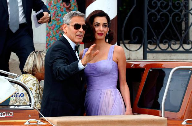 Actor and director George Clooney and his wife Amal leaves the hotel before the red carpet for the movie Suburbicon at the 74th Venice Film Festival in Venice, Italy September 2, 2017. REUTERS/Alessandro Bianchi