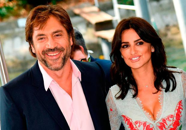 Actress Penelope Cruz and her husband Javier Bardem arrive at the 74th annual Venice International Film Festival, in Venice, Italy, Wednesday, Sept. 6, 2017. (Ettore Ferrari/ANSA via AP)