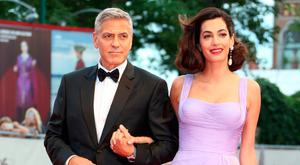 George Clooney, left, and Amal Clooney pose for photographers upon arrival at the premiere of the film 'Suburbicon' during the 74th edition of the Venice Film Festival in Venice, Italy, Saturday, Sep. 2, 2017. (Photo by Joel Ryan/Invision/AP)