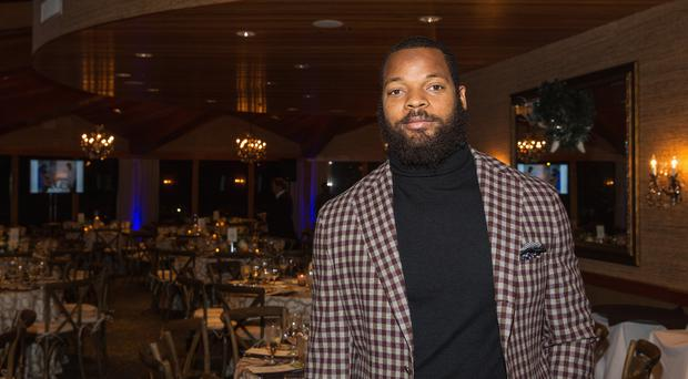 Seattle Seahawks Defensve End Michael Bennett attends the FAM 1st FAMILY FOUNDATION Charity Event at The Edgewater Hotel on December 14, 2014 in Seattle, Washington. (Photo by Mat Hayward/Getty Images for 1st Family Foundation)