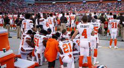 A group of Cleveland Browns players kneel in a circle in protest during the national anthem prior to a preseason game against the New York Giants at FirstEnergy Stadium on August 21, 2017 in Cleveland, Ohio. (Photo by Joe Robbins/Getty Images)