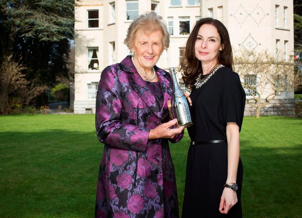 Award: Anna May McHugh is presented with the Veuve Clicquot Business Woman of the Year Award 2013 by Caroline Sleiman. Photo: Anthony Woods