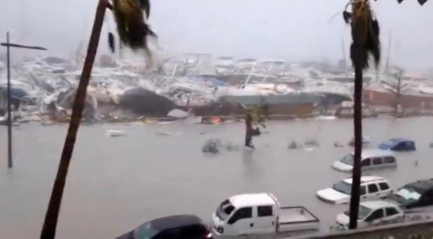 Half-submerged vehicles, boats and debris in the flooded harbour of Saint Martin. Photo: REUTERS