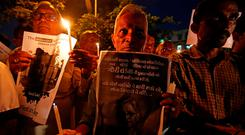 People hold placards and candles during a vigil for Gauri Lankesh, a senior Indian journalist who according to police was shot dead outside her home. Photo: REUTERS