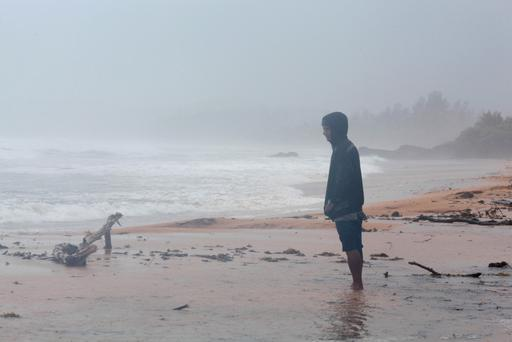 A man stands on the beach as Hurricane Irma slammed across islands in the northern Caribbean on Wednesday, in Luquillo, Puerto Rico September 6, 2017. REUTERS/Alvin Baez