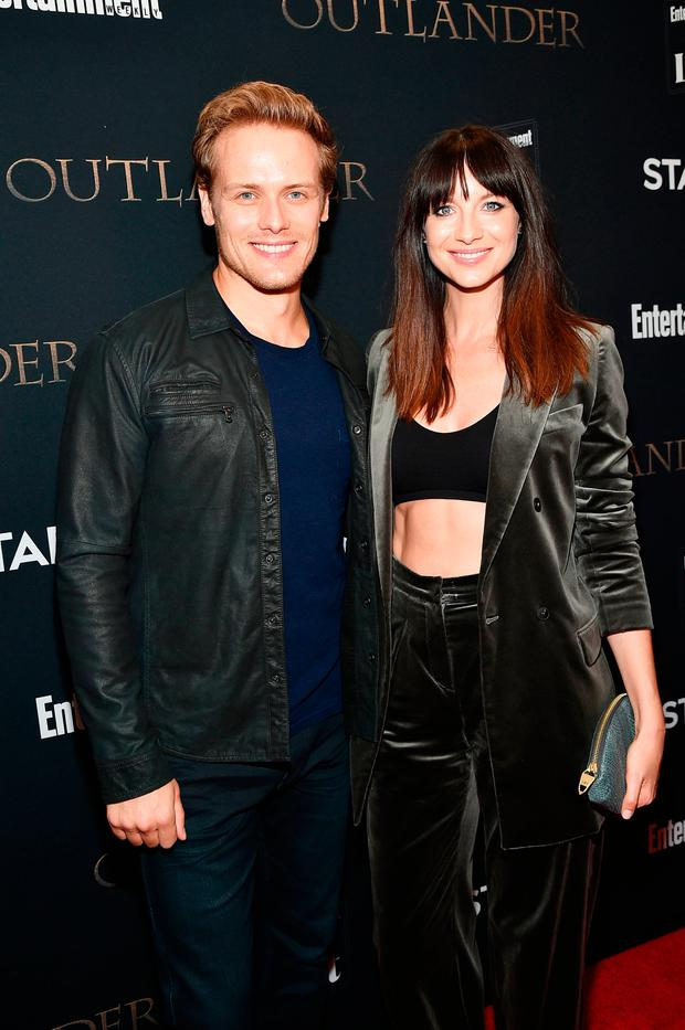 Actors Sam Heughan and Caitriona Balfe attend the New York Red Carpet Premiere of Outlander Season Three, Hosted by Starz and Entertainment Weekly in New York on September 5, 2017 in New York City. (Photo by Mike Coppola/Getty Images for Entertainment Weekly)