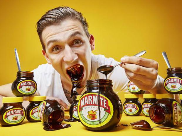Andre Ortolf holds the record for the most Marmite eaten in one minute in the latest edition of Guinness World Records (PA)