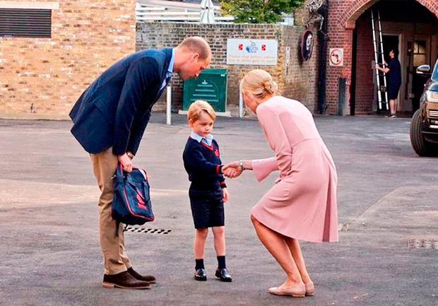 Prince George arriving with the Duke of Cambridge at Thomas's Battersea in London, as he starts his first day of school. Photo: Kensington Palace/PA Wire