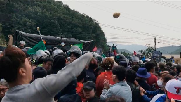 REFILE - CORRECTING BYLINE A man throws an object at the convoy of vehicles during a protest opposing the deployment of a Terminal High Altitude Area Defense (THAAD) system in Seongju, South Korea, in this still image taken from a September 7, 2017 social media video. MANDATORY CREDIT. Han Sung/via REUTERS THIS IMAGE HAS BEEN SUPPLIED BY A THIRD PARTY. MANDATORY CREDIT. NO RESALES. NO ARCHIVES