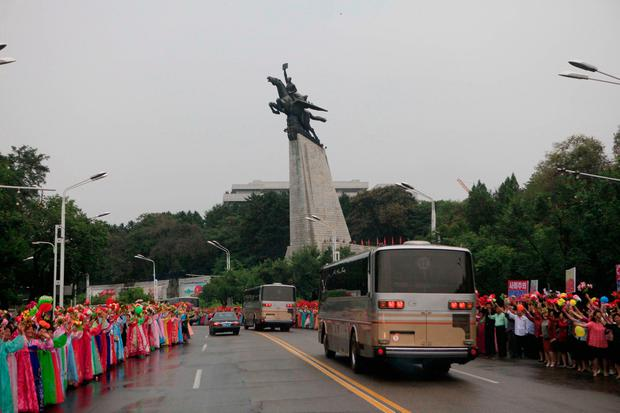 In this Wednesday, Sept. 6, 2017 photo, Pyongyang residents welcome contributors to their countryÕs sixth underground nuclear test, in Pyongyang, North Korea. The test of what Pyongyang claims was an H-bomb small enough to be mounted on an intercontinental ballistic missile was the biggest North Korea has ever conducted. (AP Photo/Jon Chol Jin)