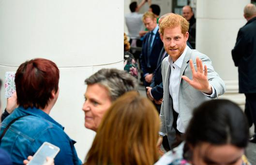 Britain's Prince Harry greets people during a visit to St. Anne's Square in Belfast, Northern Ireland
