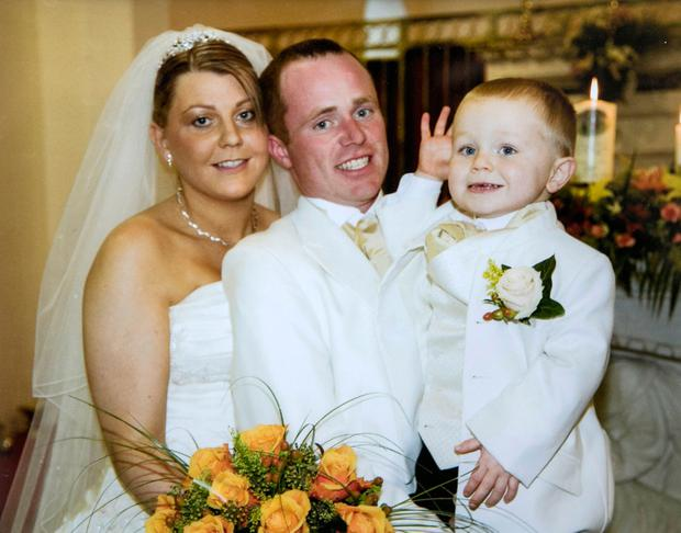 Evelyn Wakefield on her wedding day with her husband Clive and son Cian, now 12.
