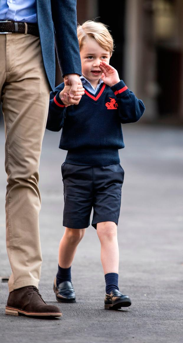 Britain's Prince George (R) accompanied by Britain's Prince William (L), Duke of Cambridge arrives for his first day of school at Thomas's school in Battersea, southwest London on September 7, 2017. / AFP PHOTO / POOL / RICHARD POHLERICHARD POHLE/AFP/Getty Images