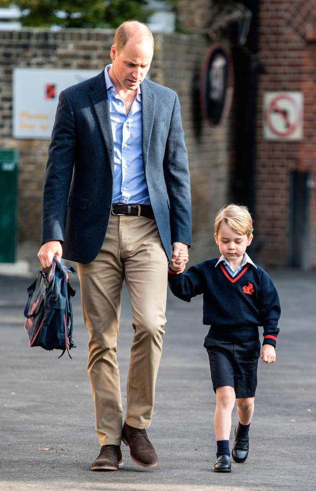 Britain's Prince George accompanied by Britain's Prince William (L), Duke of Cambridge arrives for his first day of school at Thomas's school in Battersea, southwest London on September 7, 2017. / AFP PHOTO / POOL / RICHARD POHLERICHARD POHLE/AFP/Getty Images