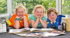 Pictured ahead of the launch of the 'New Ross Kennedy Book and Research Archive' at New Ross Library are From left; Hannah 8yrs, Heidi 6yrs and Peadar Maher 2yrs from Oldross, Co.Wexford. Credit: Mary Browne