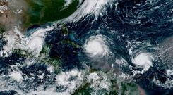 Hurricane Irma, Hurricane Jose (R) and Hurricane Katia (L) are pictured in the Atlantic Ocean in this September 7, 2017 NOAA satellite handout photo. NOAA/Handout via REUTERS
