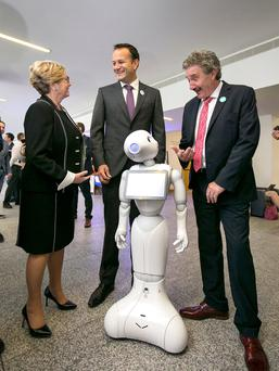 Taoiseach Leo Varadkar, Tánaiste Frances Fitzgerald and Skills Minister John Halligan with Pepper the Robot at the launch of four Science Foundation Ireland research centres. Photo: Frank McGrath