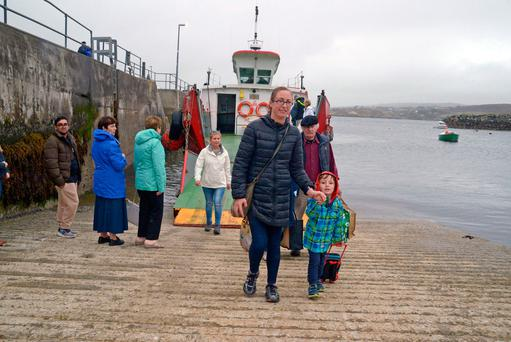 Olive O'Neill collects her son William from the ferry on Sherkin Island. Photos: Denis Boyle