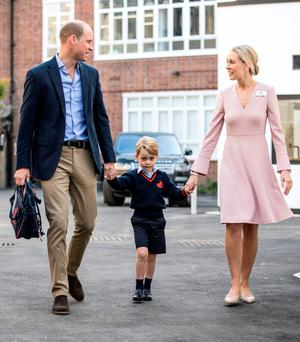 Prince William and his son George with Helen Haslem of Thomas's Battersea on his first day at the London school Picture: Reuters