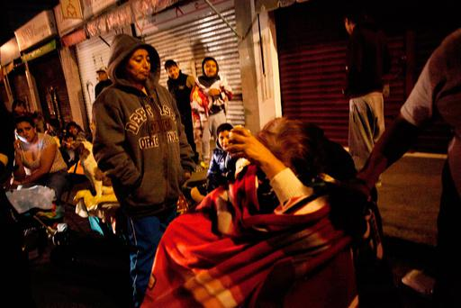 People gather on a street in the Tlatelolco neigborhood of Mexico City during an earthquake / AFP PHOTO / PEDRO PARDOPEDRO PARDO/AFP/Getty Images