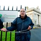 Cllr. Christy Burke chains himself to the railings of The Customs House, Dublin, to highlight the inaction of Government over the housing crisis. Picture: Caroline Quinn