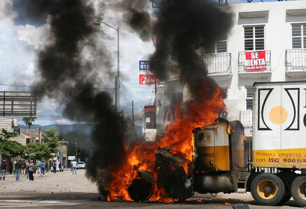 A truck burns after it was set on fire during protests against Mexico's President Enrique Pena Nieto who arrived on an official visit, in Oaxaca, Mexico September 7, 2017. REUTERS/Jorge Luis Plata