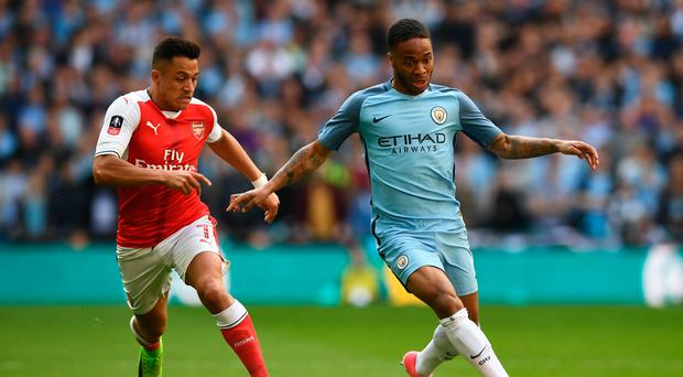 Arsenal's Chilean striker Alexis Sanchez (L) vies with Manchester City's English midfielder Raheem Sterling during the FA Cup semi-final football match between Arsenal and Manchester City at Wembley stadium in London on April 23, 2017. / AFP PHOTO / Justin TALLIS