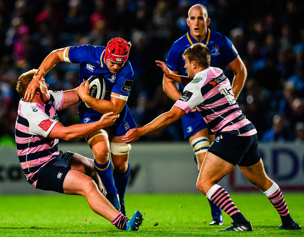 Josh van der Flier of Leinster is tackled by Rhys Gill of Cardiff Blues during the Guinness PRO14 Round 2 match between Leinster and Cardiff Blues at the RDS Arena in Dublin. Photo: Sportsfile