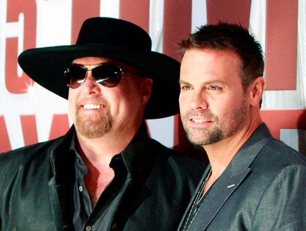Country music duo Montgomery Gentry, Eddie Montgomery (L) and Troy Gentry, arrives at the 45th Country Music Association Awards in Nashville, Tennessee November 9, 2011. REUTERS/Harrison McClary/File Photo