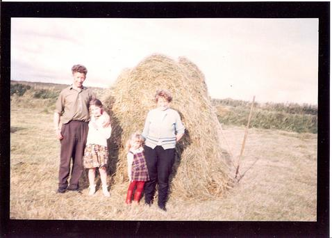 Ancient rituals: Kevin's father, Sonny, with his daughter Angela, sister Mary and niece Ellen, haymaking in Dookinella on Achill in the 1960s. Photo: ManyRivers Films