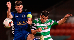 Shamrock Rovers' David McAllister clashes with Bluebell United's Shane Stritch during last night's FAI Cup quarter-final. Photo: Sportsfile